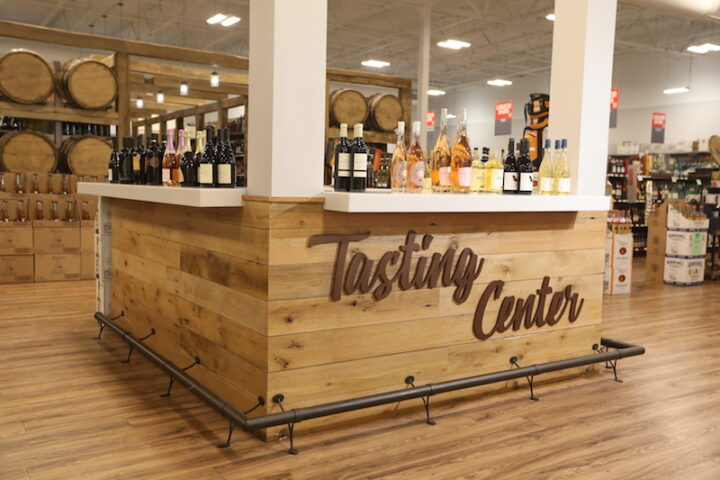 Tasting centers (pictured) were shut down during the pandemic but are reopening with new safety protocols like plexiglass partitions and the use of single-serve drinkware.