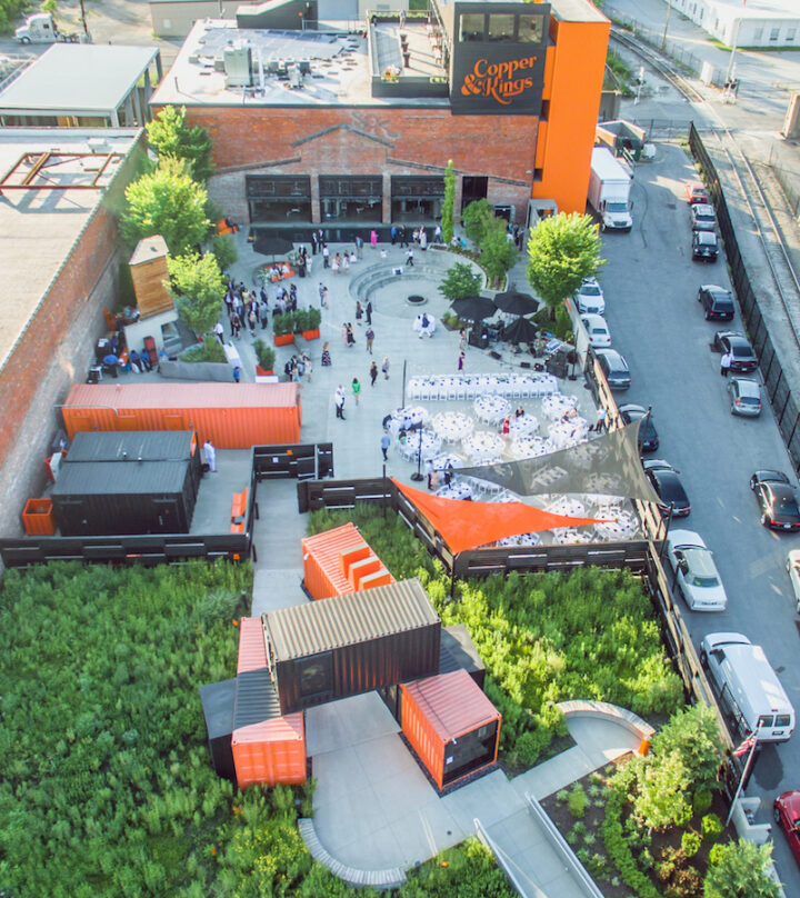 Copper & Kings has become a big part of the Louisville, Kentucky community. Its facility encompasses a large courtyard (pictured) with a barn—perfect for an array of events—as well as a reflecting pool, a bar, and a gallery featuring works by local artists.