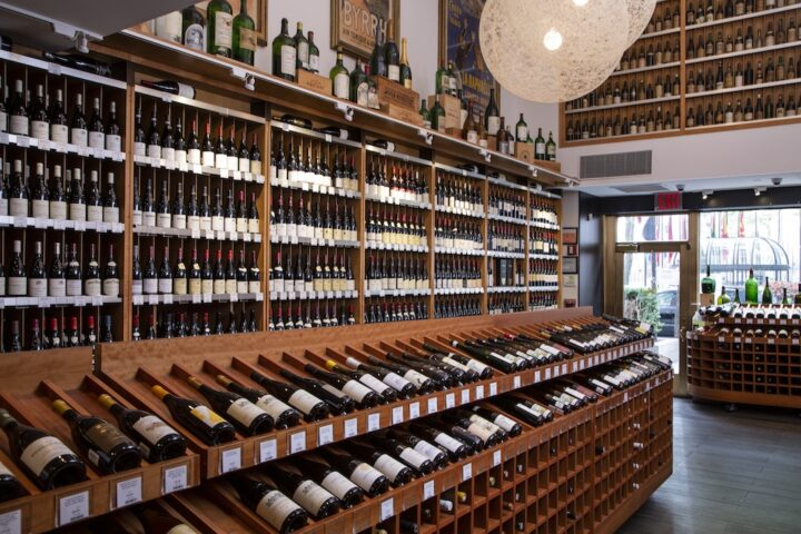 Morrell says his company is focused on its core business, which is selling higher-end wines (wine shelves pictured) and catering to collectors.