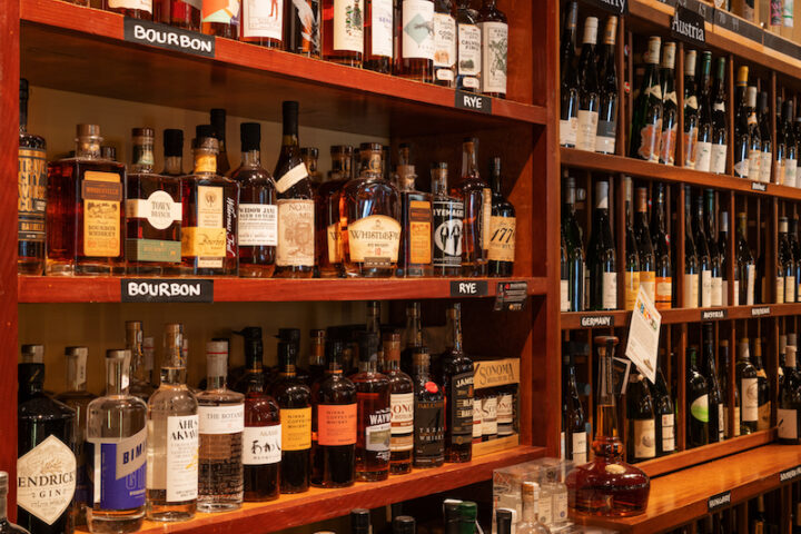 Zachareas and Granoff try every wine they stock themselves, and have employees well-versed in spirits (shelves pictured) and beer do the same for those departments.