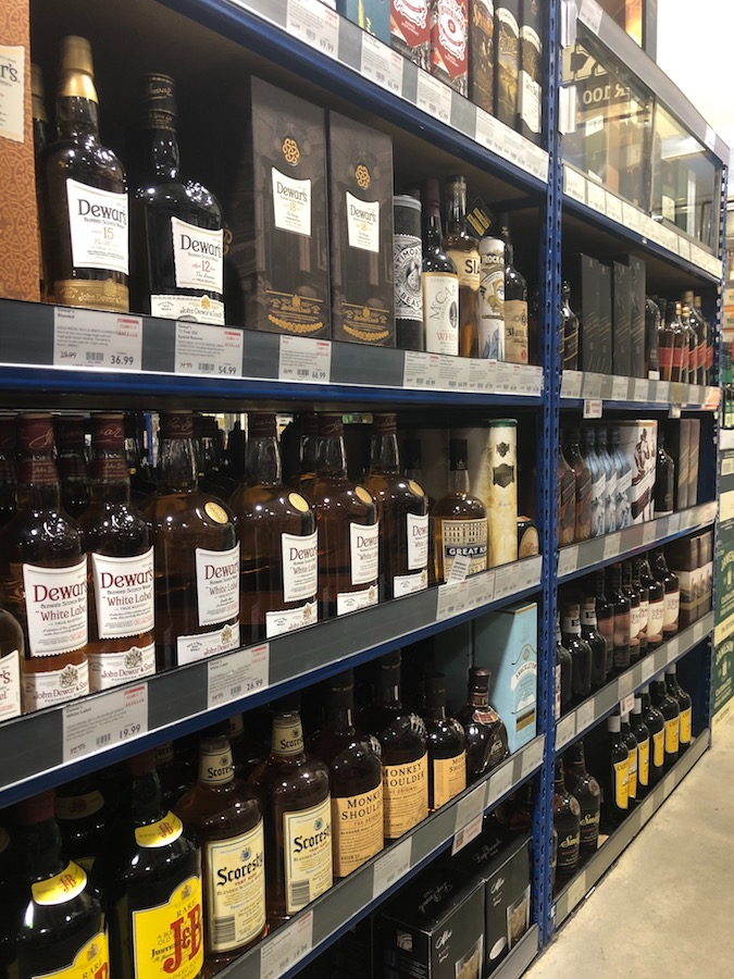 Though blended Scotch has fallen out of favor at BevMo stores (shelves pictured) in recent years, high-end brands like Johnnie Walker Blue Label are bucking the trend.