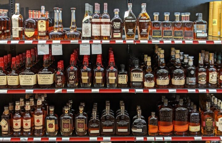 Supply issues didn't stop whiskies (shelf pictured) from remaining on consumers' minds in 2020, according to Downtown Spirits.