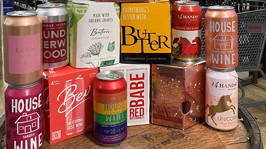 As canned wine (BevMo selection pictured) grows more popular, established brands like Underwood and House Wine are being joined by newcomers like Anheuser-Busch InBev-owned Babe wine brand.