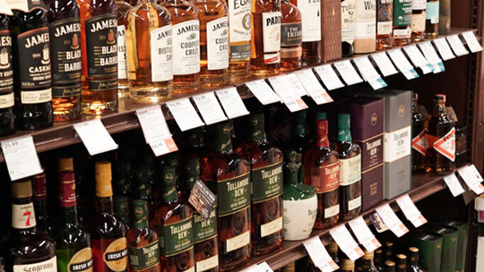 Irish whiskey (Florida-based ABC Fine Wine & Spirits shelves pictured) reached more than 5 million cases in 2020 in the U.S., with super-premium brands driving growth for the category.