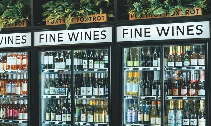 At 63% of all beverage alcohol sales, wine (coolers pictured) is the biggest growth driver for Foxtrot, with its largest locations carrying up to 350 SKUs.