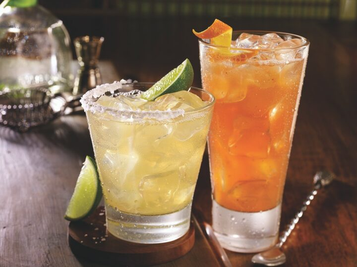 Popular cocktails at TGI Fridays include the Margarita (left) and tiki-style cocktails such as the Barbados Rum Punch (right).