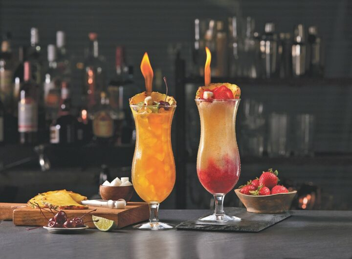 Tropical cocktails, such as the Flaming Mai Tai (left) and Flaming Frozen Lava Flow (right), do extremely well at TGI Fridays.