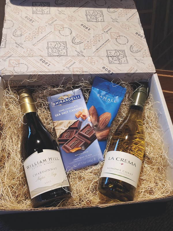 The Last Hotel expects to continue its wine takeout program (white wine box pictured), at-home boxes, and cocktail class and overnight stay package even after the pandemic is over.