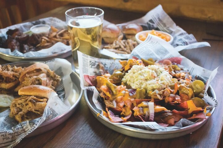 HonkyTonk Saloon (nachos and beer pictured) has an extensive bar program, offering domestic and imported beers along with spirits and Champagne bottle service in its VIP room.