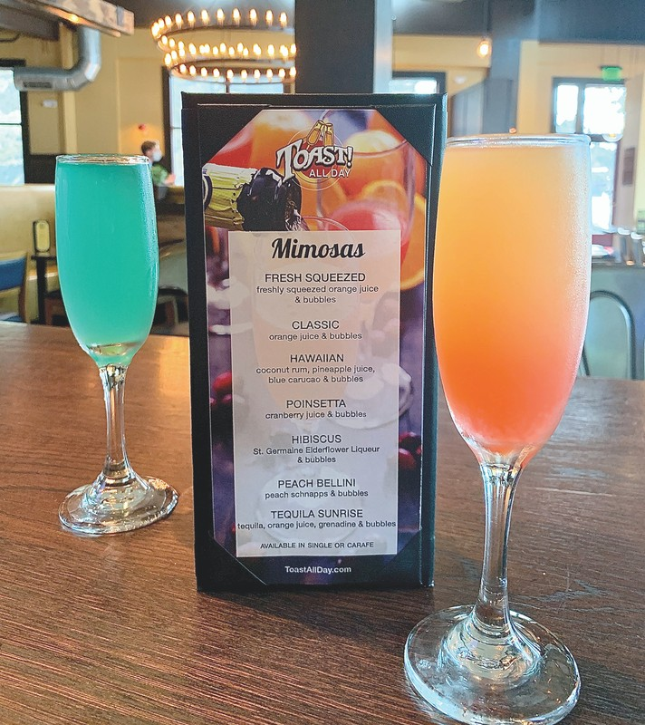 Toast offers a variety of Mimosas (pictured) and Bloody Marys.