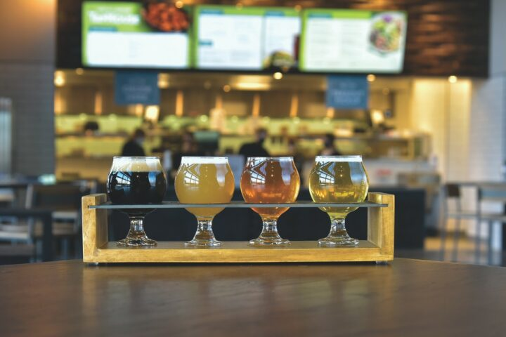 The craft brewing industry has been deeply impacted by the Covid-19 pandemic. Delaware-based Iron Hill Brewery (beer flight pictured) completely revamped its strategy, as the company's operations were previously 95% on-premise before Covid-19.