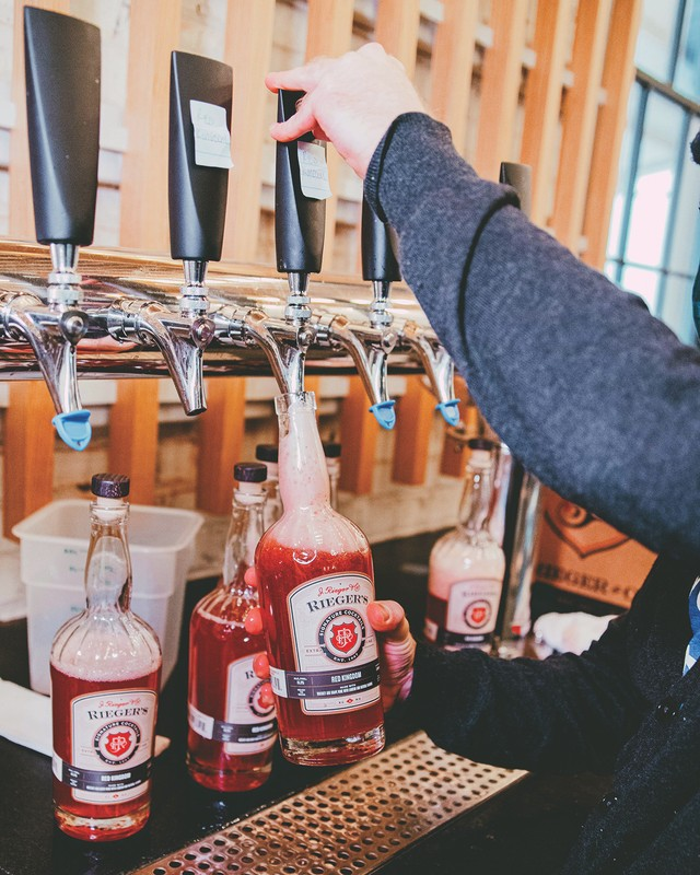 Kansas City's J. Rieger & Co. has sold more than $83,000 worth of bottled cocktails (Red Kingdom cocktail bottling pictured) during the pandemic.