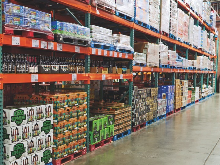 Of the 803 Costco units worldwide, 496 are licensed to sell beer (shelves pictured). Overall, craft labels and hard seltzers are driving the category, which makes up 20% of beverage alcohol sales at the retailer, though mainstream offering Corona Extra remains a bestseller.