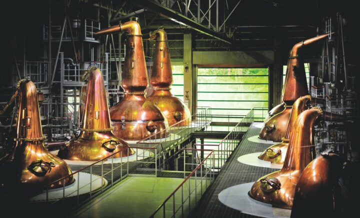 Japanese whisky owes much of its history to Masataka Taketsuru, who apprenticed at a number of Scottish distilleries before bringing his knowledge back to Japan and joining Kotobukiya Ltd., the predecessor to Suntory (Hakushu Distillery stills pictured).