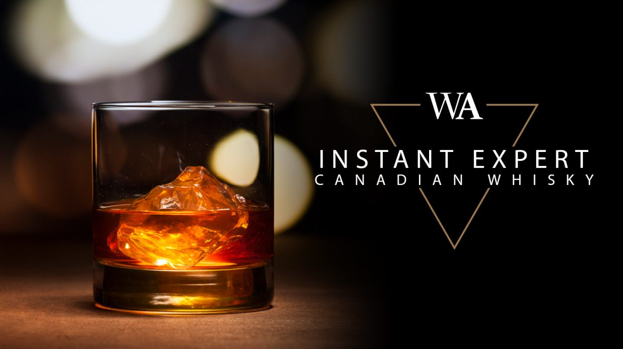 """Rocks glass filled with whisky, with the words """"Instant Expert Canadian Whisky"""" and Whisky Advocate logo."""