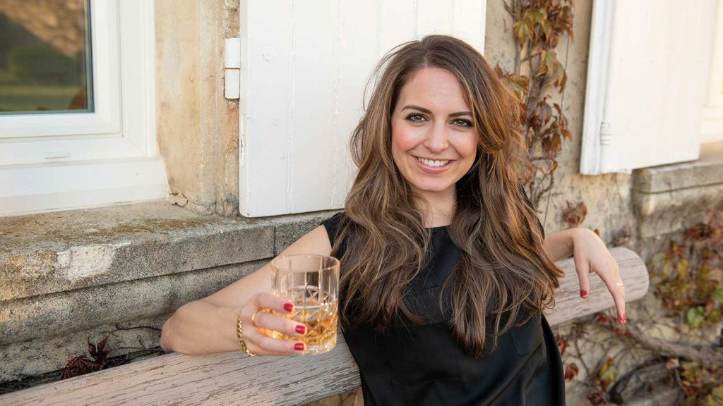 allison parc of brenne whisky holding a glass of whisky