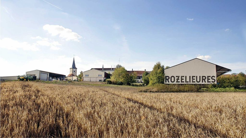 g rozelieures distillery in a field of grain in France's Lorraine region