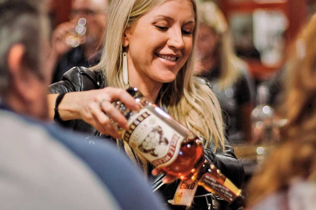 A woman pours from a bottle of Belle Meade bourbon at Nelson's Green Briar Distillery on Clinton Street in Nashville, Tennessee.