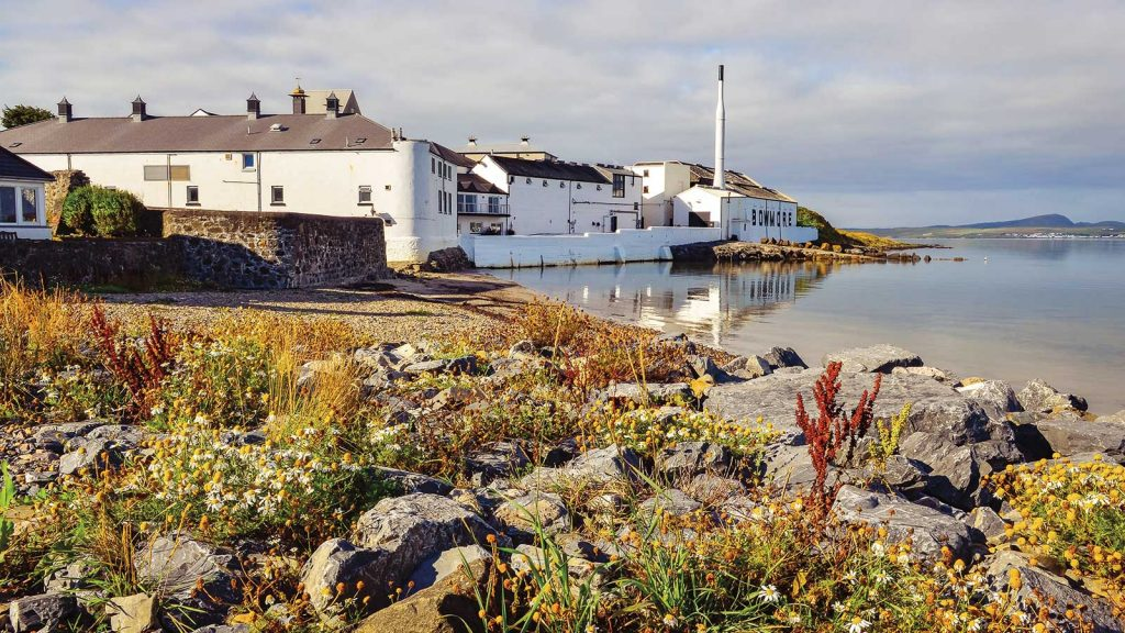 A view of Bowmore Distillery, set on the water's edge on the rugged island of Islay, Scotland.