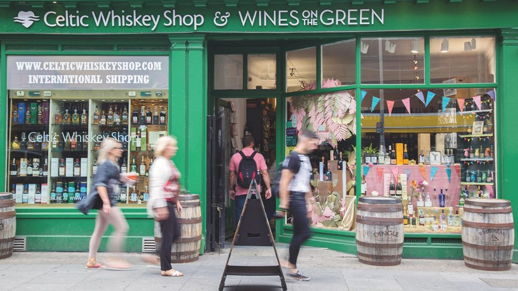 The bright green storefront of Dublin's Celtic Whiskey Shop.