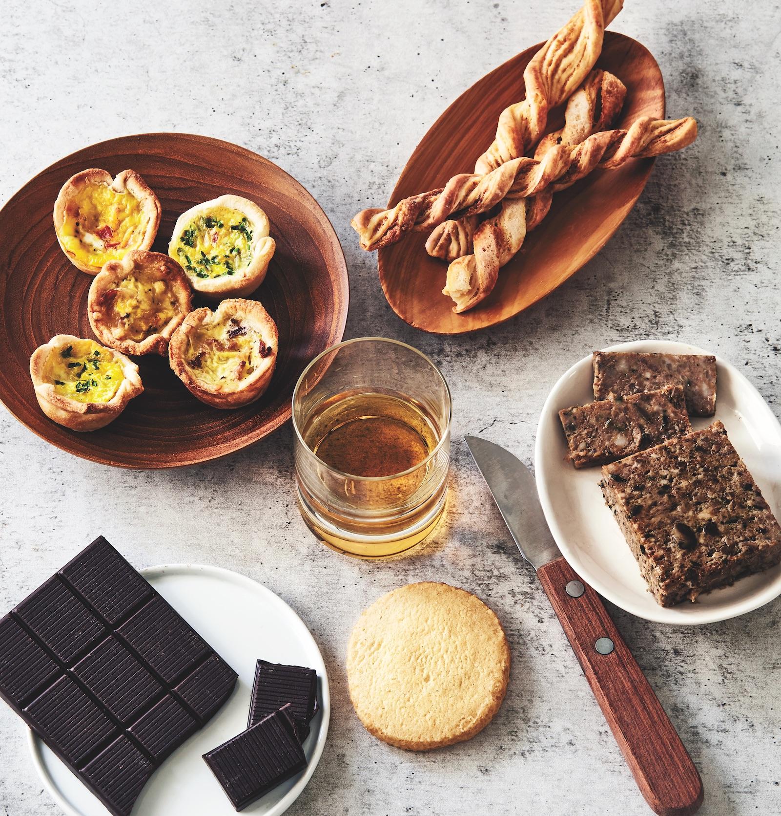 quiche, cheese straws, dark chocolate, paté, and vanilla cookie with a glass of Irish whiskey