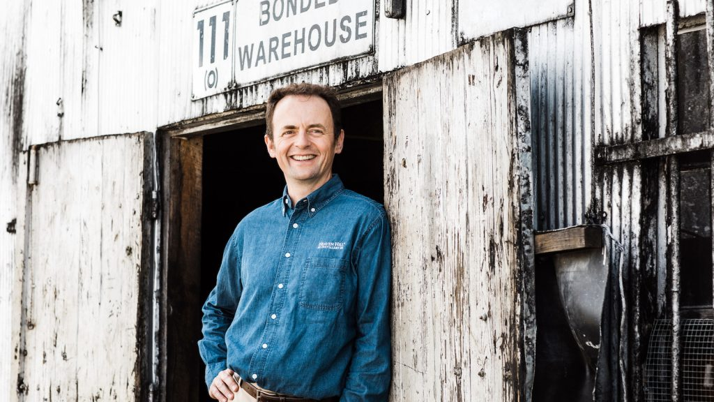 heaven hill master distiller conor o'driscoll in front of a bonded warehouse