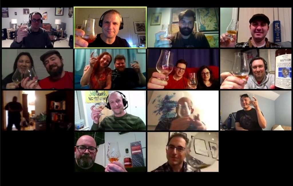 A screen shot taken by Adam Safir, one of the main organizers for the Washington, D.C.-based Islay Scotch Society, during their first virtual tasting held Saturday, March 28, 2020, in which various group members are visible holding up Glencairn glasses containing what appears to be whisky.