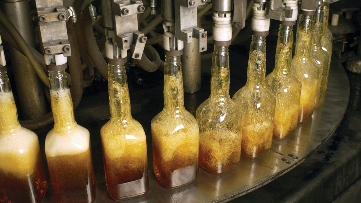 bottles of bourbon being filled