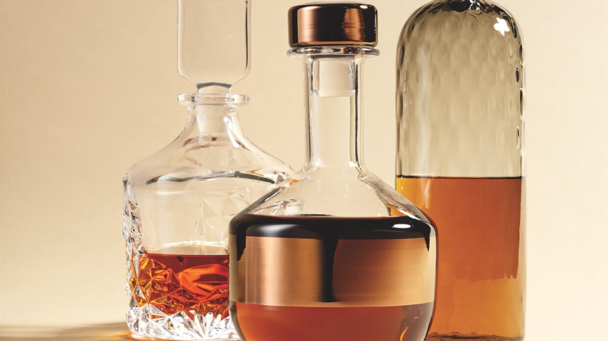 A trio of whisky decanters.