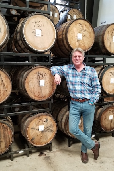 Colin Keegan, owner of Santa Fe Spirits in New Mexico, stands in the rickhouse in January 2020.