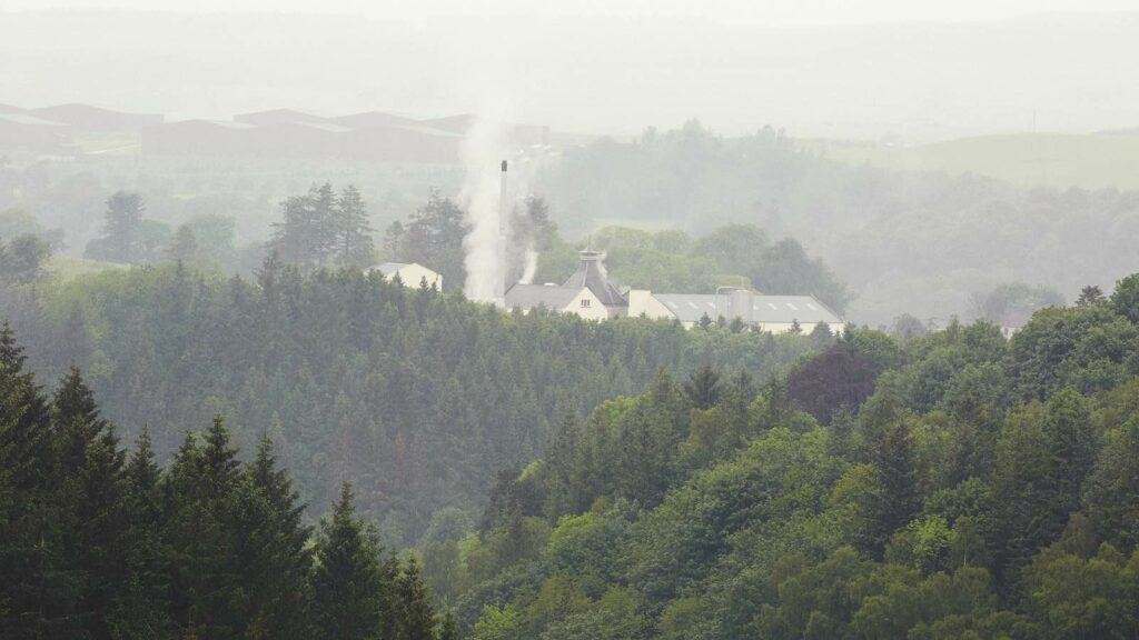 craigellachie distillery seen through the trees of speyside