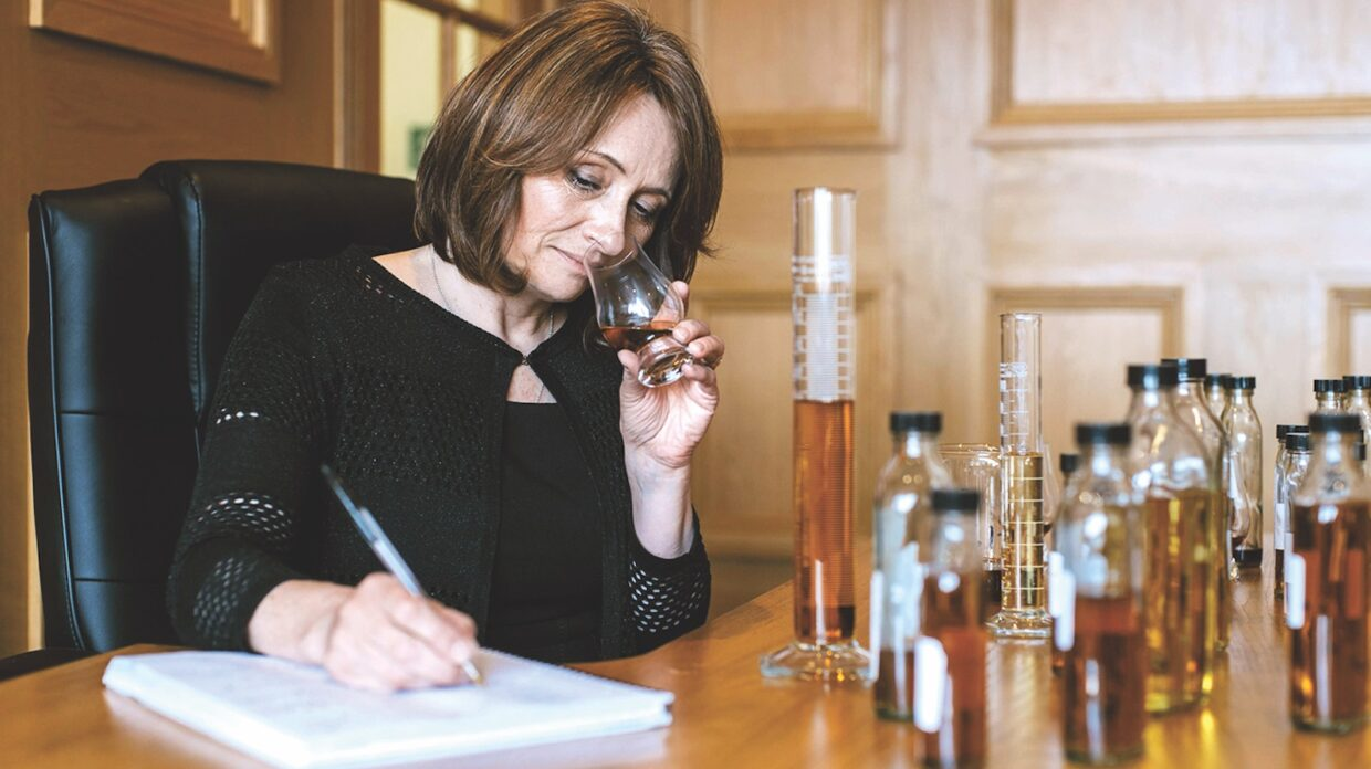 Master blender Rachel Barrie noses whisky samples and takes notes.