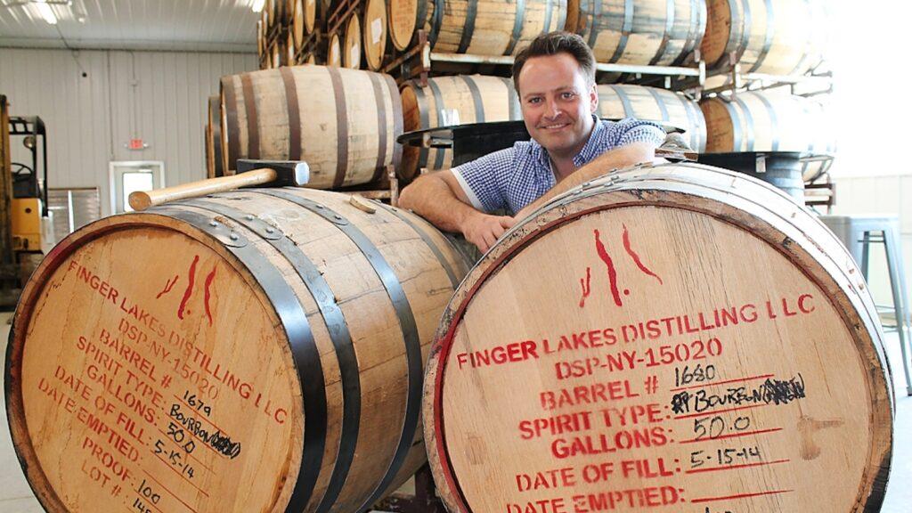 Owner Brian McKenzie with bourbon barrels at Finger Lakes Distilling in Burdett, New York.