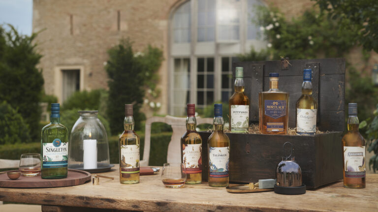 the 2020 diageo special releases collection of single malt scotches, on a table outside of a manor house