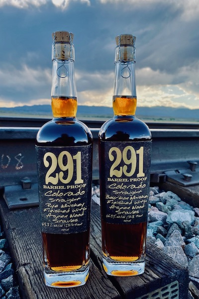 Distillery 291 Colorado rye and bourbon bottles by railroad tracks