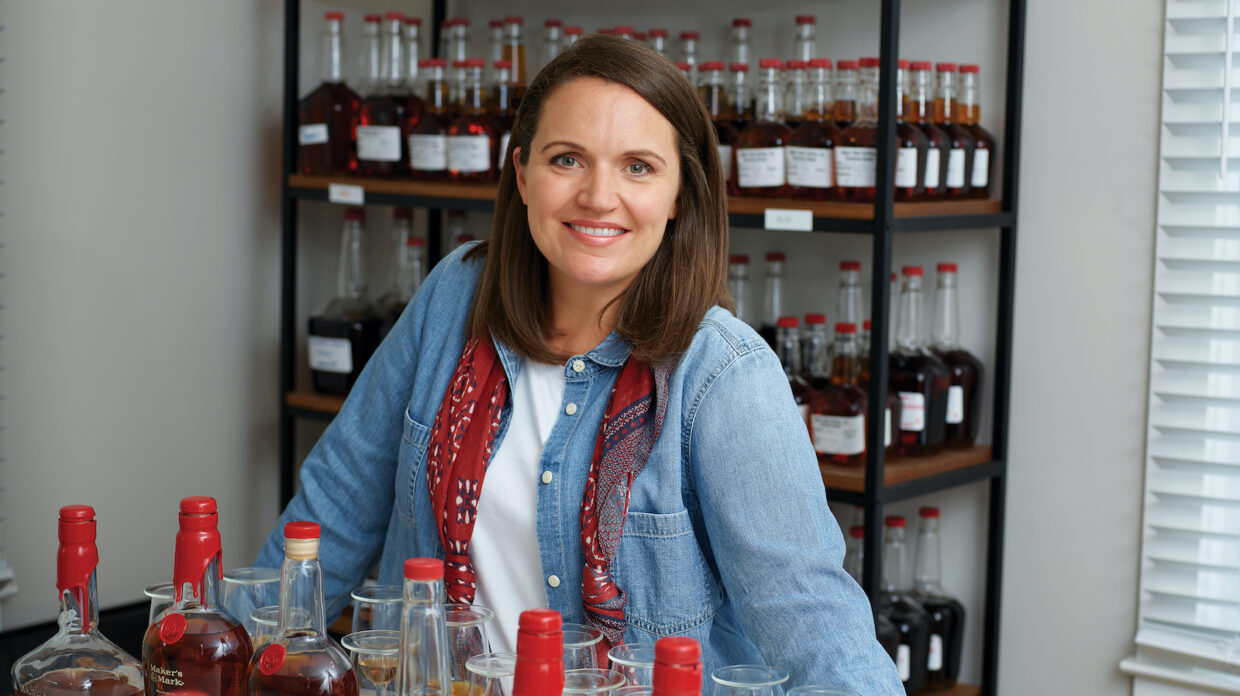Maker's Mark director of innovation Jane Bowie, with bottles of bourbon in her lab