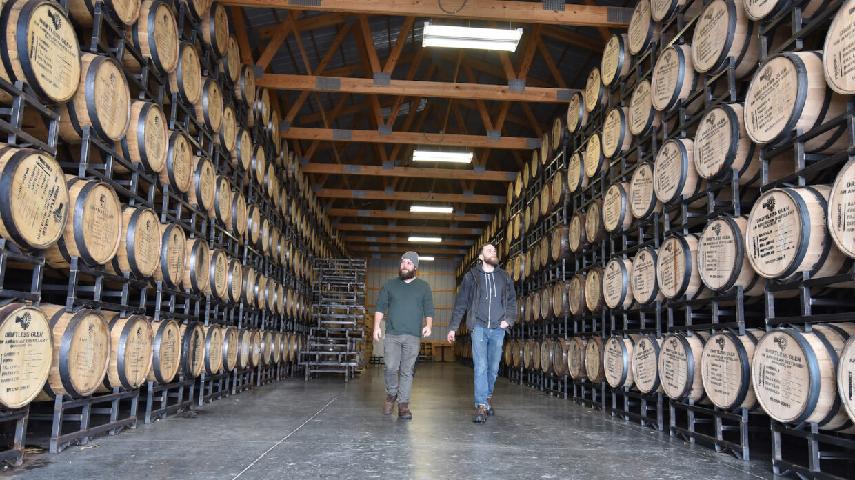 Head distillers Max Thibodeaux and NathanMahinski walk through the rackhouse at Driftless Glen Distillery in Baraboo, Wisconsin.
