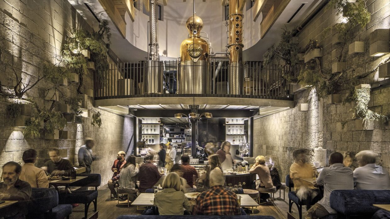 Interior view of the Family Jones, with distillery equipment above the dining area