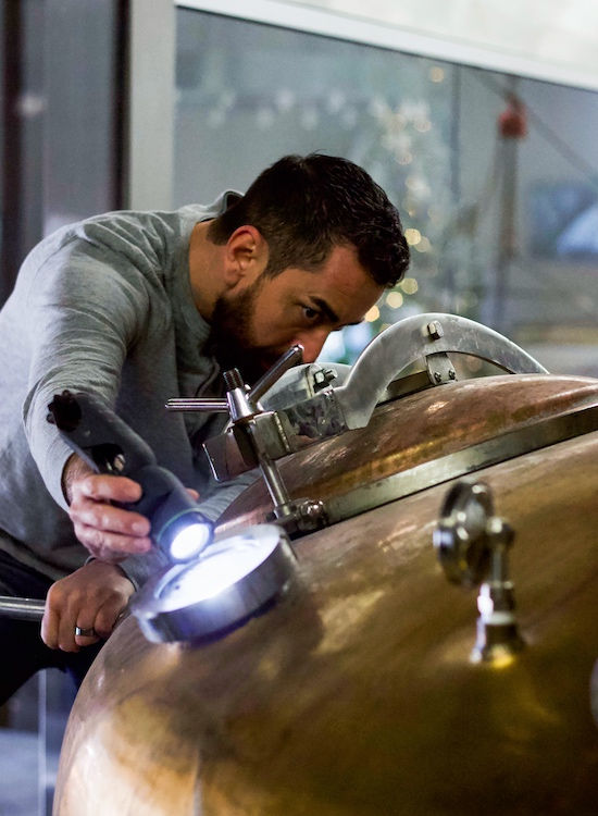 Union Horse Distilling Co. master distiller and co-founder Patrick Garcia peers into a still.