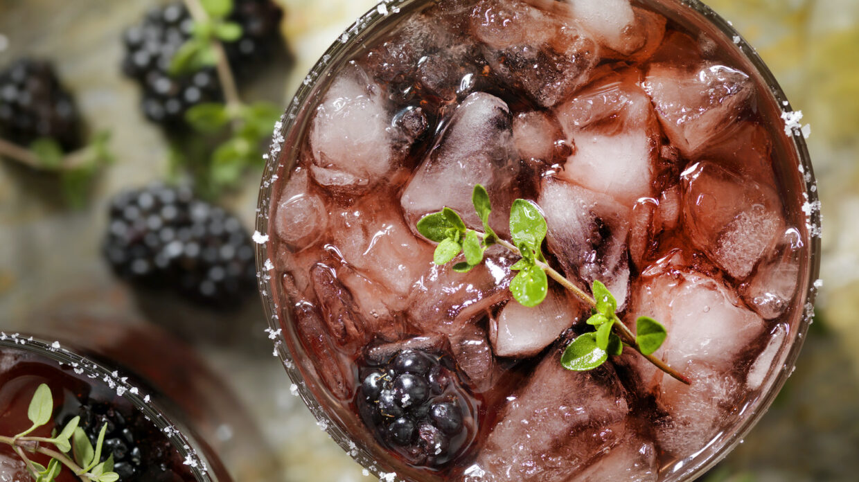 A blackberry and whiskey cocktail.