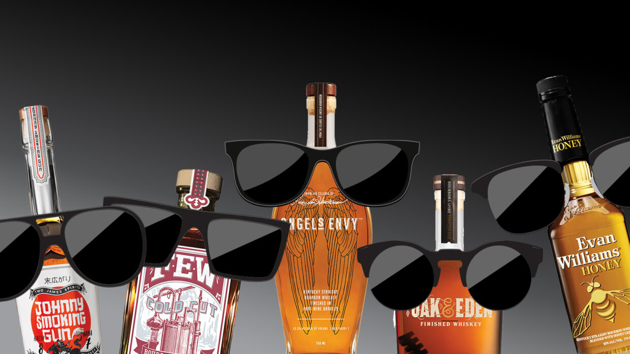 whiskey bottles with goofy sunglasses on top