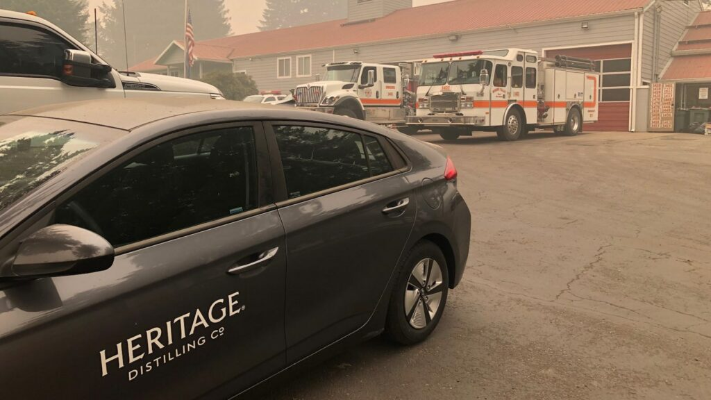 A Heritage Distilling Co. car is parked outside the Mohawk Valley fire department in Marcola, Oregon.