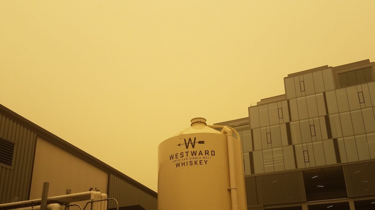 Silo at Westward Whiskey in Portland, Oregon with dull yellow sky due to wildfires