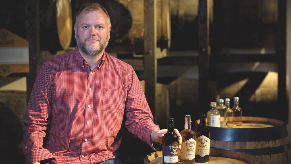 Alex Chasko poses with a range of Teeling Irish whiskeys.