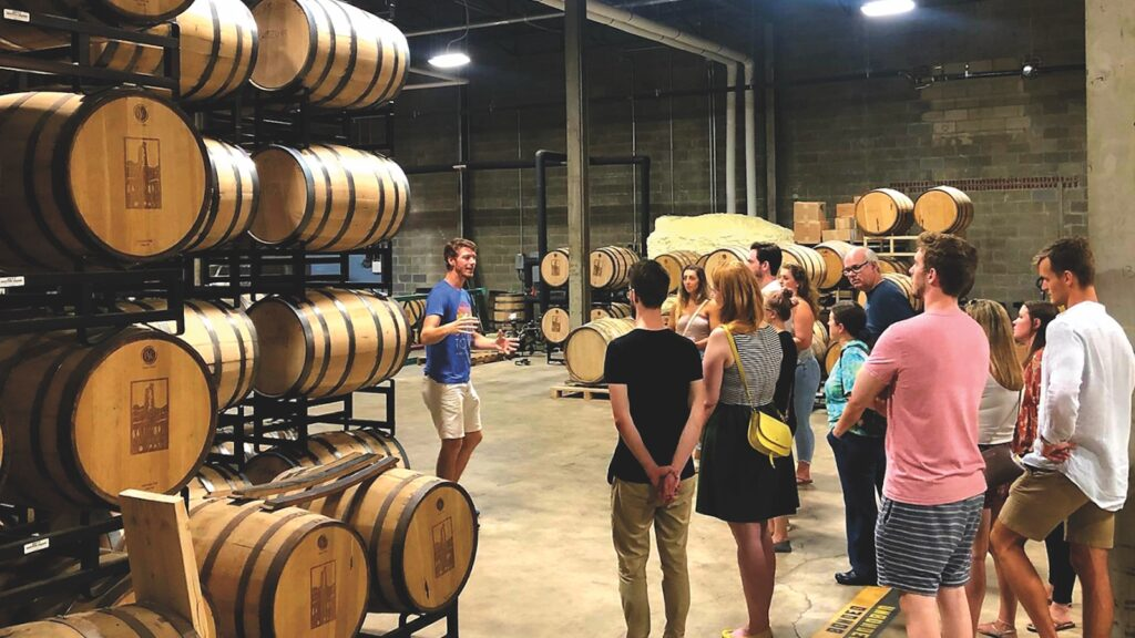 A tour guide leads a group at Baltimore Spirits Company.