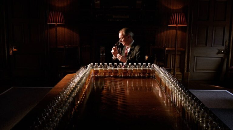Chivas Brothers master blender Colin Scott noses a glass of whisky at a table filled with sample bottles