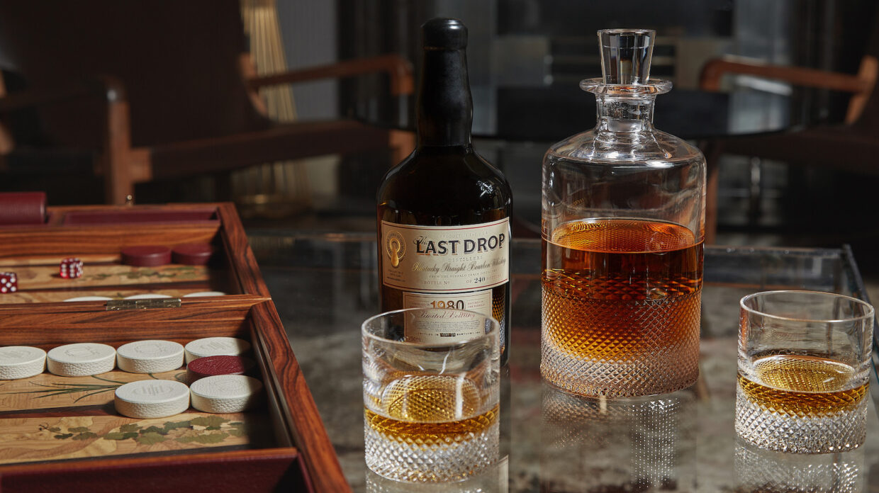 The Last Drop 1980 Buffalo Trace 20 year old bourbon, next to a decanter and some glasses of whiskey