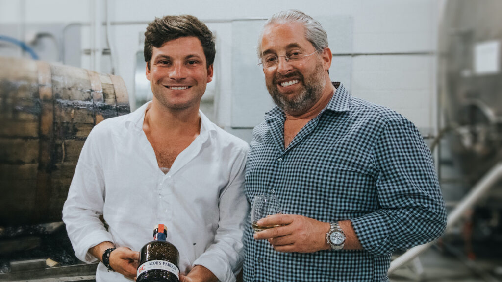 Jake Taub and father Marc Taub with the first bottle of Jacob's Pardon 8 year old Small Batch whiskey