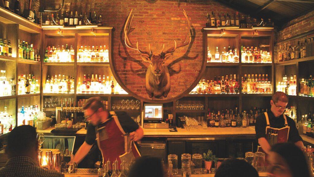 Bartenders make drinks at The Elk Room.