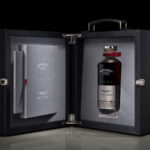a bottle of Black Bowmore DB5 made in partnership with aston martin in a custom case